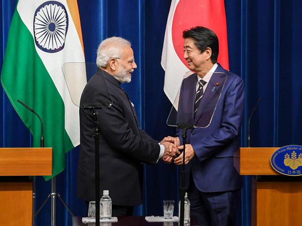 Modi Shinzo Abe shaking hands