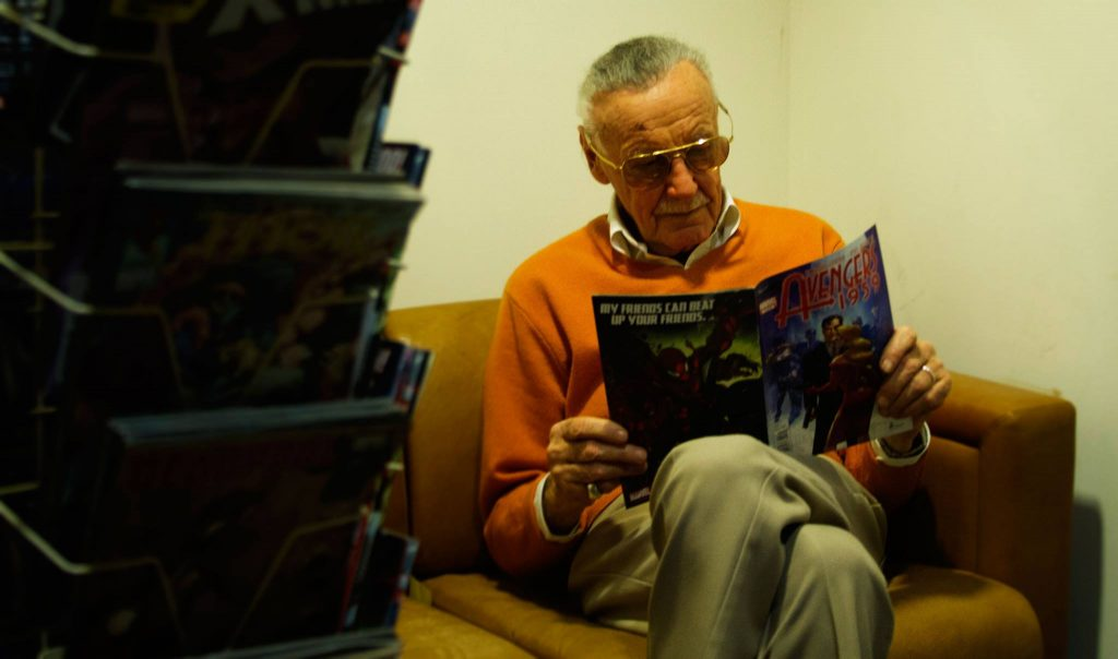 Stan Lee reading comic book