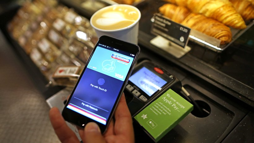 A consumer making online payment through mobile payment app Apple Pay
