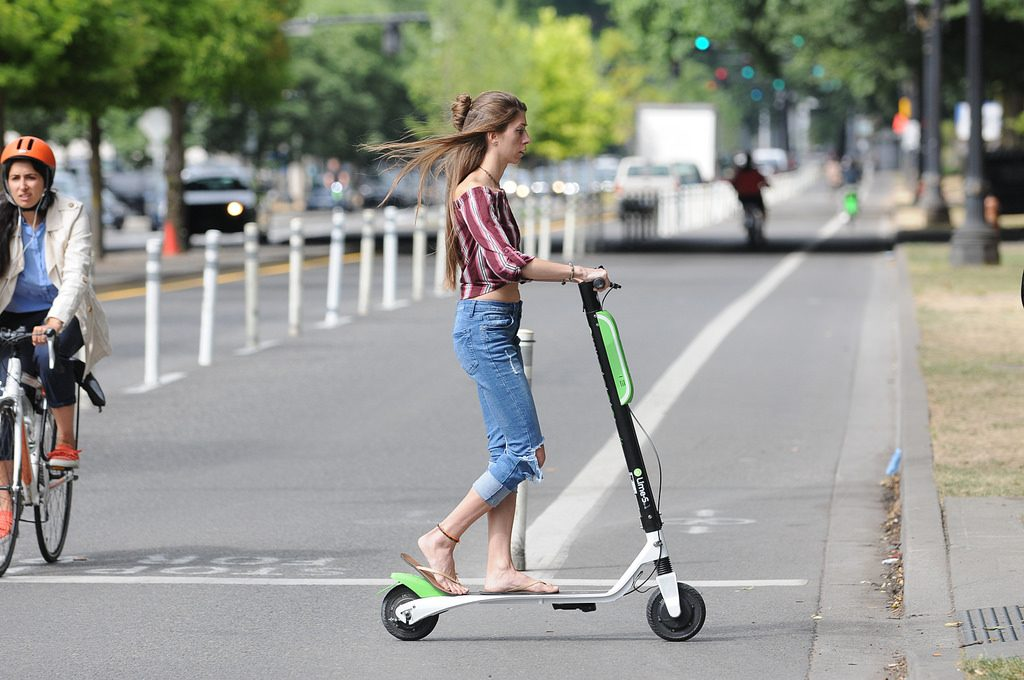 A women riding e-scooter