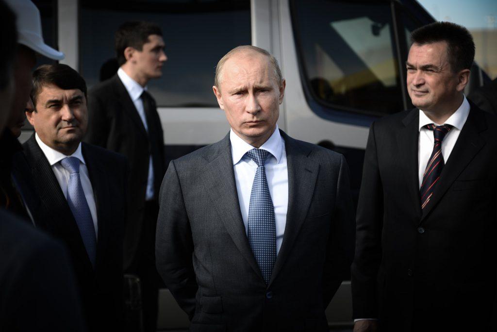 Vladimir Putin with bodygaurds